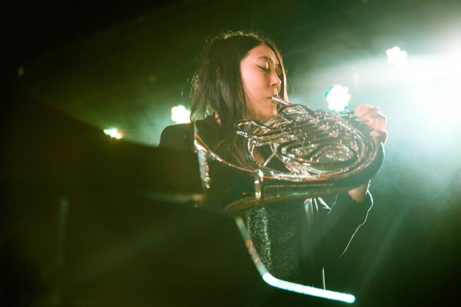 Sasami the French horn player in King Tuff's band performing at the Basement East in Nashville.
