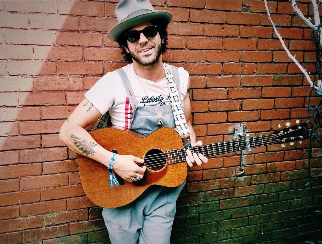 Langhorne Slim with his Martin guitar and an Indian guitar strap by Original Fuzz