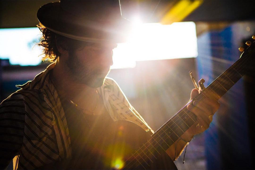 Langhorne slim performs with his acoustic guitar and an Indian guitar strap by Original Fuzz