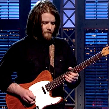 Laur Joamets performs with Sturgill Simpson on Letterman in his Peruvian guitar strap