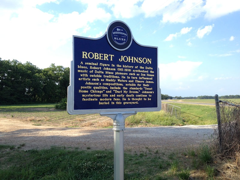 The trail marker and churchyard at Robert Johnson's grave in Greenwood, MS