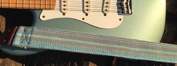 The Savannah guitar strap with a seafoam green Stratocaster