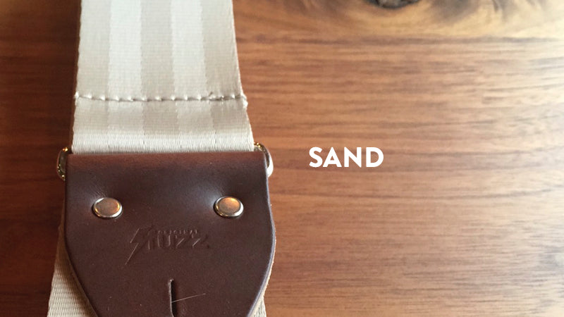 Our seatbelt guitar strap in Tan