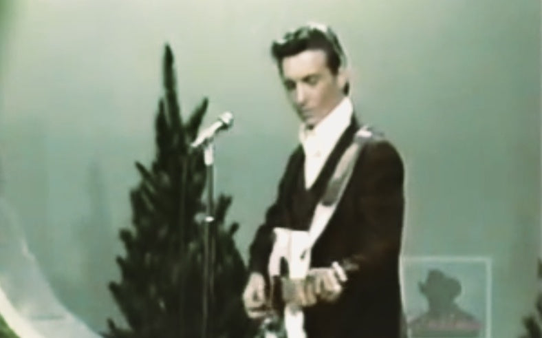 Waylon Jennings performs in front of a Christmas tree in 1967