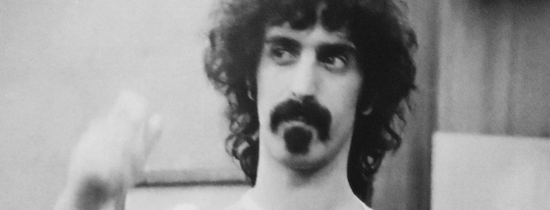 Close up of Frank Zappa's face during a recording session