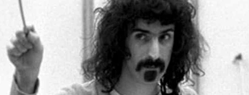Frank Zappa conducts an orchestra