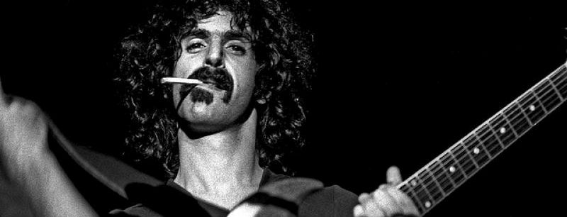 Frank Zappa with a cigarette and guitar