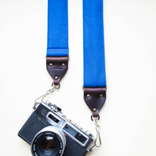 Blue vintage-style cotton canvas camera strap made by Original Fuzz in Nashville with a Yashica film camera.