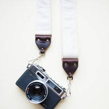 Cream white cotton canvas vintage-style camera strap made by Original Fuzz in Nashville, TN with Yashica film camera.