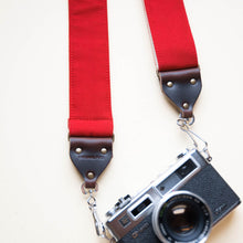Red cotton canvas vintage-style camera strap made by Original Fuzz in Nashville with a Yashica film camera.