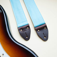 Light arctic blue cotton canvas vintage-style guitar strap made by Original Fuzz in Nashville, TN with a Fender Jazzmaster.