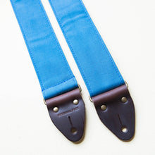 Blue vintage-style cotton canvas guitar strap with antique brass hardware made by Original Fuzz in Nashville.