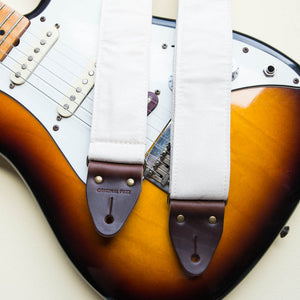Cream white cotton canvas vintage-style guitar strap made by Original Fuzz in Nashville, TN with a Fender Jazzmaster.