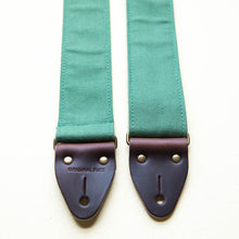 Green cotton canvas guitar strap with antique brass hardware and Horween leather made by Original Fuzz