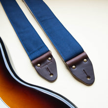 Navy blue cotton canvas guitar strap made by Original Fuzz with a Fender Jazzmaster.