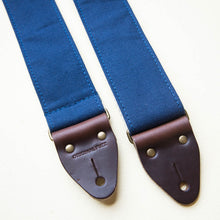 Navy blue cotton canvas vintage-style guitar strap made with Horween leather and antique brass hardware by Original Fuzz.