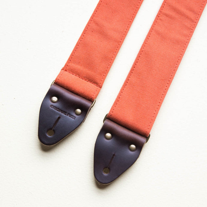 Paprika orange cotton canvas vintage-style guitar strap with antique brass hardware and Horween leather made by Original Fuzz in Nashville, TN.