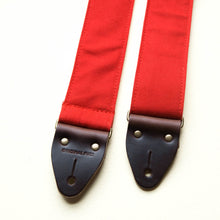 Red cotton canvas vintage-style guitar strap with antique brass hardware made by Original Fuzz in Nashville.