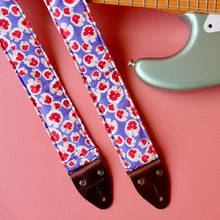 Purple and red classic floral pattern lightweight cotton handmade guitar strap with a Fender guitar.