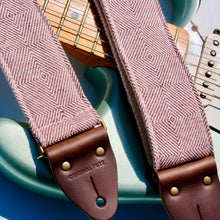 Red woven guitar strap made with fair-trade fabric from India by Original Fuzz in Nashville.