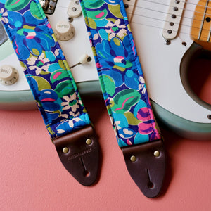 Blue floral silk guitar strap handmade in Nashville by Original Fuzz.