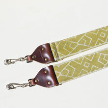 Vintage-style camera strap by Original Fuzz made with Indian block-printed cotton fabric in green with a traditional cream margosa design.