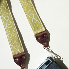 Vintage-style camera strap by Original Fuzz with Indian fabric.