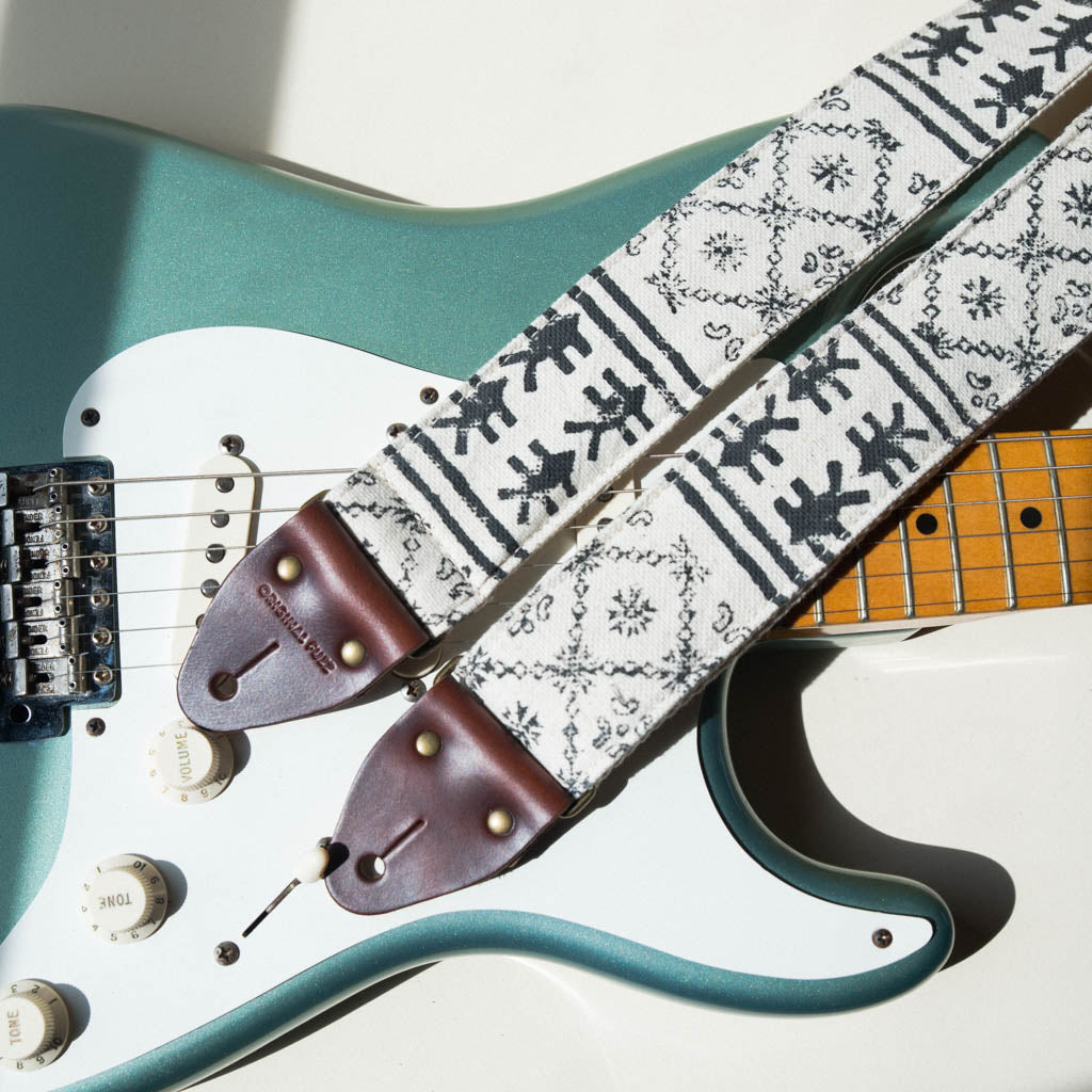 Vintage-style guitar strap made with black ink block-printed on white cotton fabric from India by Original Fuzz on Fender Stratocaster.