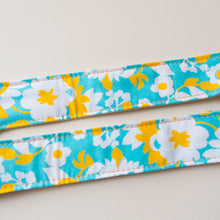 Vintage-style guitar strap made with repurposed light blue and yellow floral cotton by Original Fuzz.
