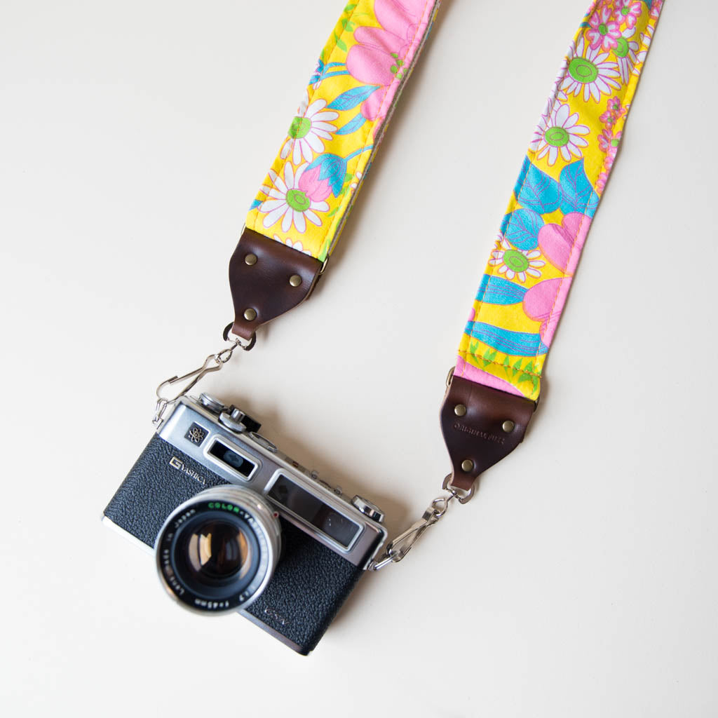 Vintage-style floral camera strap made with reclaimed yellow fabric.
