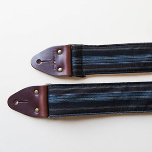 Vintage-style guitar strap made with reclaimed black striped cotton by Original Fuzz.