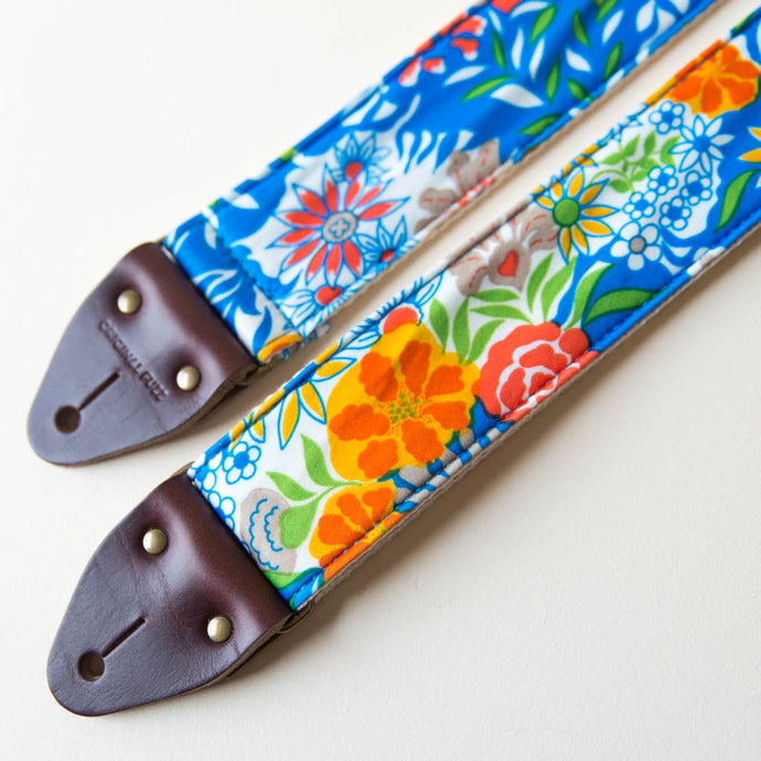Vibrant blue floral guitar strap made with reclaimed vintage polyester 1