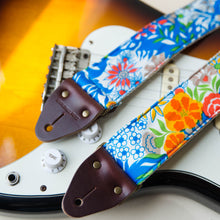 Vibrant blue floral guitar strap made with reclaimed vintage polyester 3