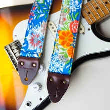 Vibrant blue floral guitar strap made with reclaimed vintage polyester by Original Fuzz.