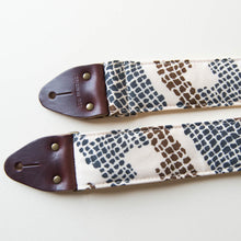 Vintage guitar strap made with repurposed 70s polyester with an abstract print by Original Fuzz.