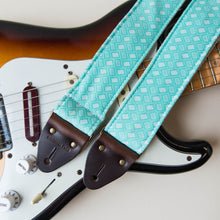 Vintage-style guitar strap made with repurposed surf green polyester with a diamond pattern by Original Fuzz.