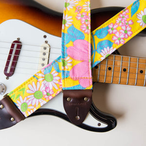 Original Fuzz vintage-style guitar strap made with repurposed yellow floral fabric.