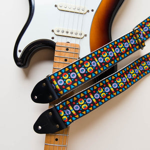 Vintage-style guitar strap made with a 60s style colorful woven jacquard by Original Fuzz.