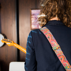 pink paisley guitar strap from the Nashville collection by Original Fuzz on model