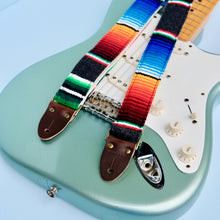 Original Fuzz Mexican serape blanket guitar strap in the new skinny width in dark grey with a Fender guitar.