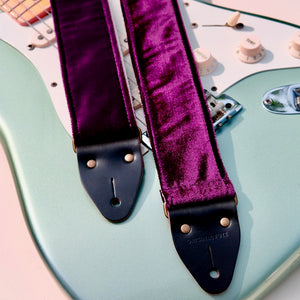 Original Fuzz purple velvet guitar strap with a Fender guitar.