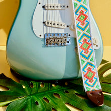 Original Fuzz summer sale 2019 featuring a vintage red, green and white guitar strap