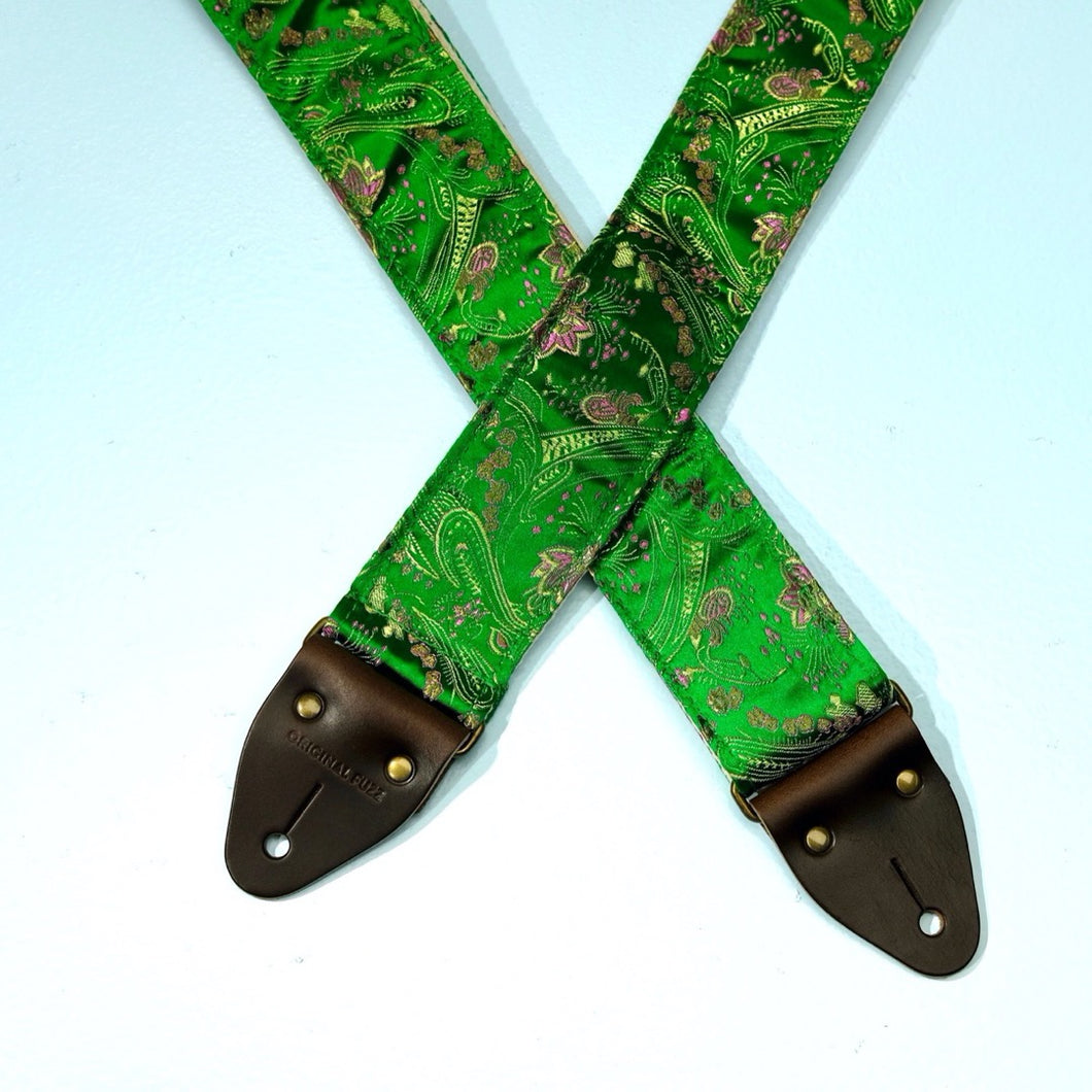 Featured photo of this silk green brocade guitar strap with paisley accents
