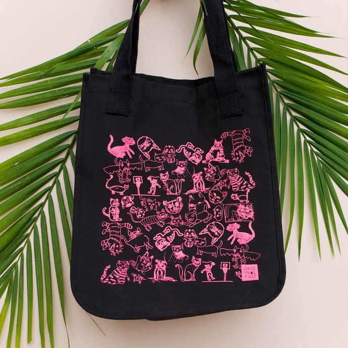 Original Fuzz black organic cotton tote bag silkscreened with hot pink Fuzz Fest cats is meant for carrying around records, groceries, whatever else you need to carry.