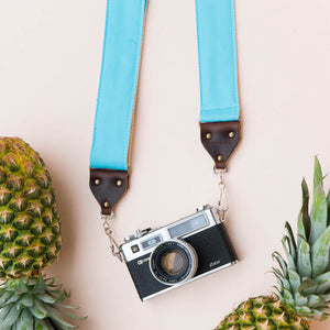 Light arctic blue vintage-style camera strap made by Original Fuzz in Nashville, TN. with a Yashica film camera.