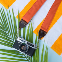 Orange cotton canvas vintage-style camera strap made by Original Fuzz with Yashica film camera.
