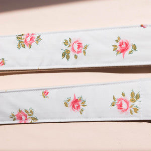Vintage guitar strap with a rose design made by Original Fuzz in Nashville, TN.