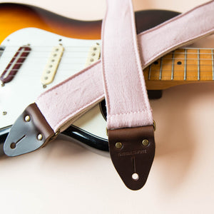 Light pink silk vintage guitar strap made by Original Fuzz.