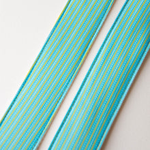 Vintage guitar strap made with 70s blue and yellow striped polyester by Original Fuzz.