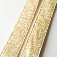 Vintage guitar strap made with repurposed yellow polyester with a repeating leaf design by Original Fuzz.
